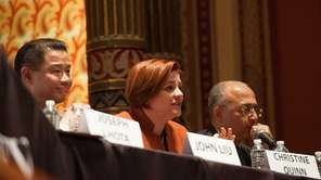 City Council Speaker Christine Quinn, center, answers a