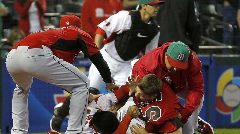 Canada's Jay Johnson, bottom right, and Mexico's Eduardo