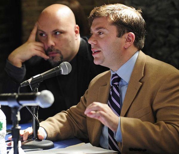 Eric Alexander, Vision Long Island, left, listens while