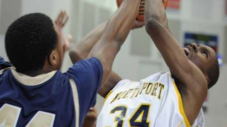 Northport's Michael Milligan Jr. fights for a rebound