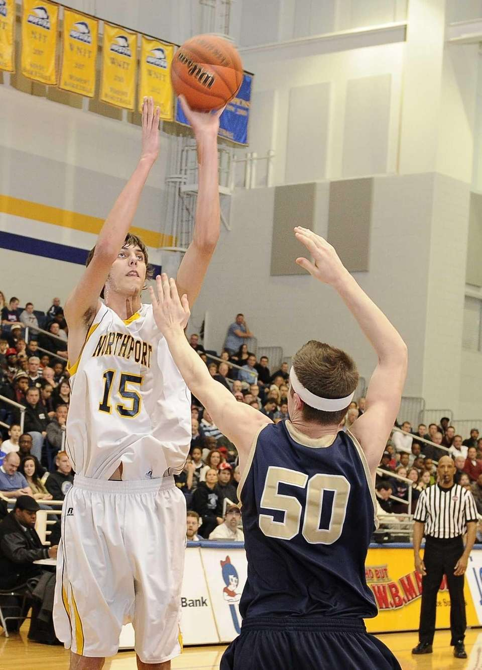 Northport's Luke Petrasek shoots ahead of Baldwin's Michael