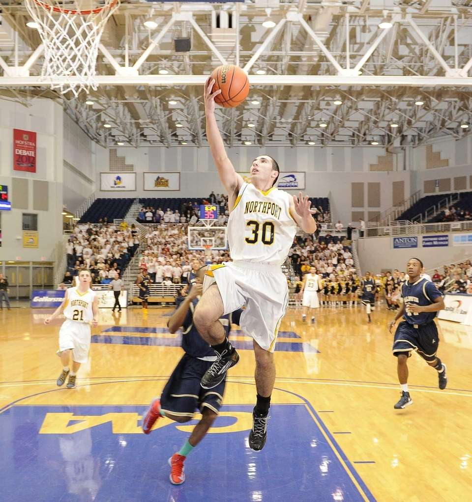 Northport's Matt Smith sinks a layup after he