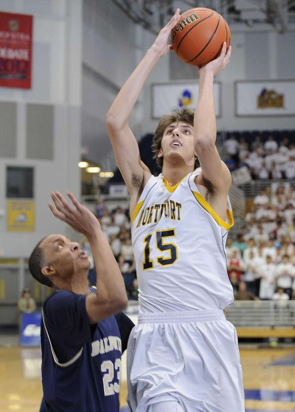 Northport's Luke Petrasek shoots the ball against Baldwin's