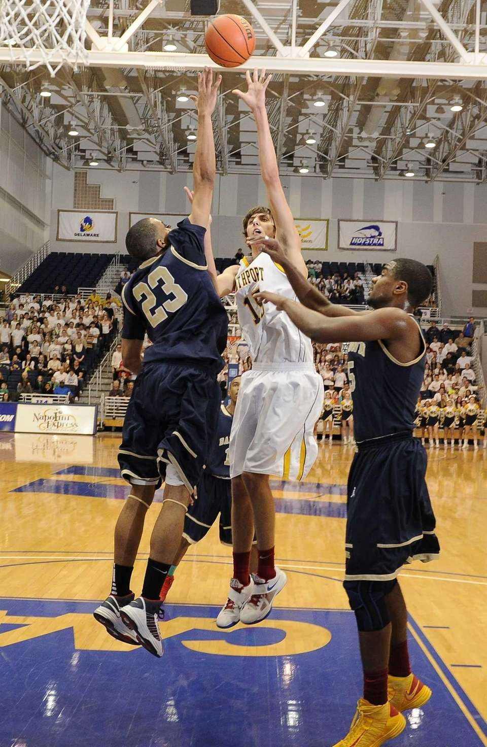 Northport's Luke Petrasek shoots past Baldwin's Eric Mack