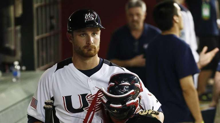 United States' Jonathan Lucroy walks out of the