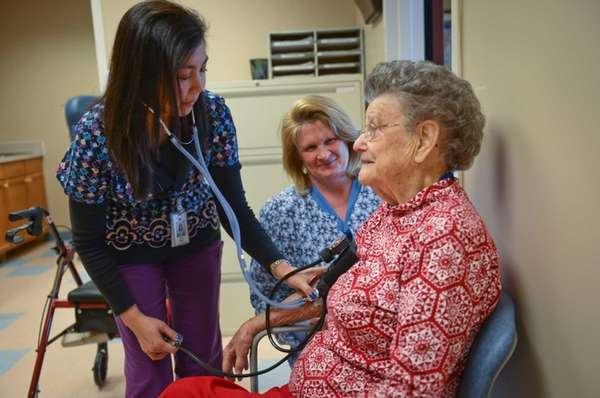 Emergency Nurse, LPN, Luz Pingco, left, takes a