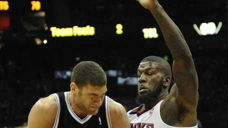 Nets center Brook Lopez makes contact with Atlanta