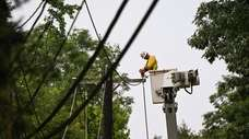 A PSEG crew and contractors work on downed