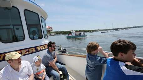 Visitors take a tour of the harbor on