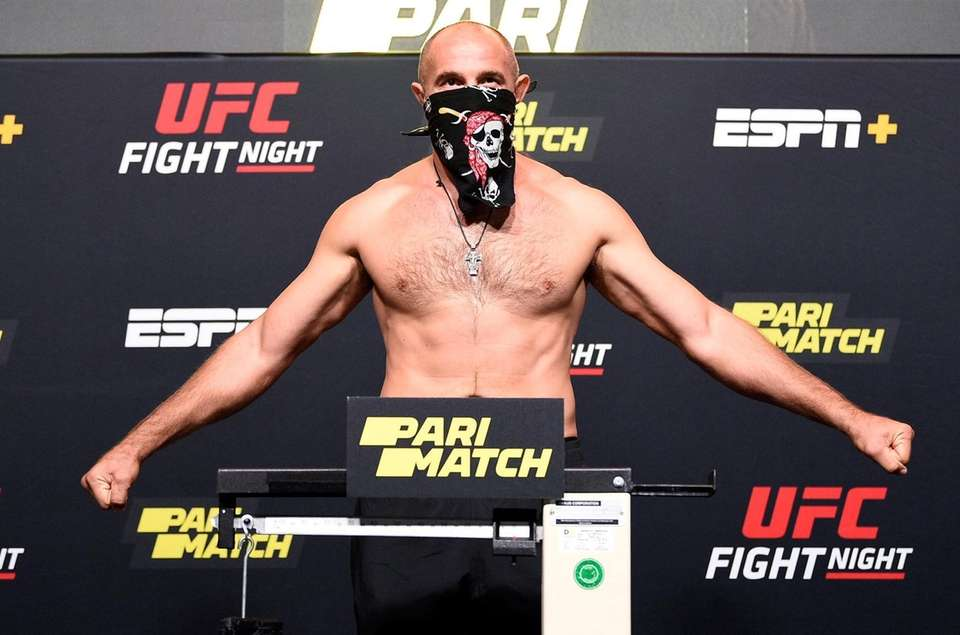 In this handout image provided by UFC, Aleksei