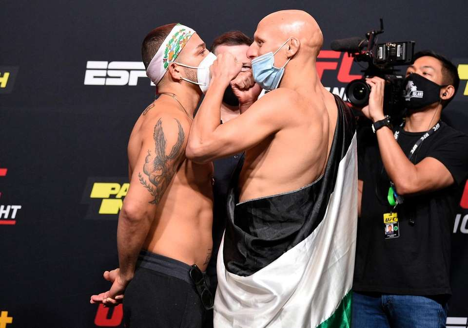 In this handout image provided by UFC, (L-R)