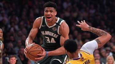 Bucks forward Giannis Antetokounmpo, knocks down Lakers forward
