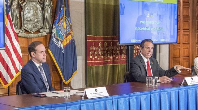 State Health Commissioner Howard Zucker, left, joins Gov.