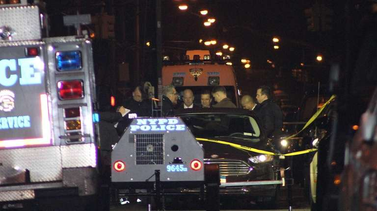 NYPD investigators gather in Brooklyn where plainclothes officers