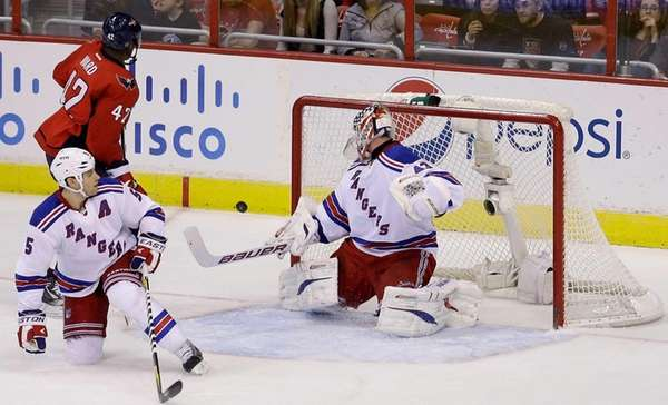 Martin Biron makes a save during the second