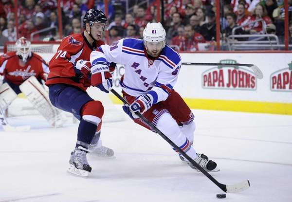 Rick Nash works the puck against Washington Capitals
