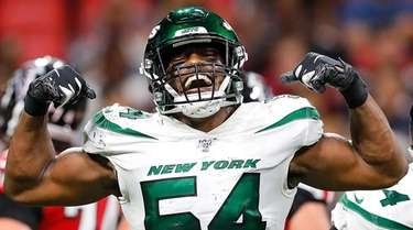Avery Williamson of the Jets reacts after sacking