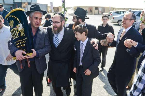 A crowd celebrates the bar mitzvah of Hudson