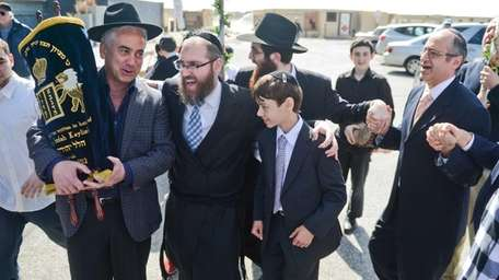 A crowd celebrates the bar mitzvah of Hudson
