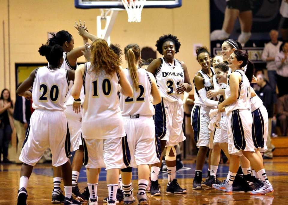 The Dowling women's basketball team celebrates its victory