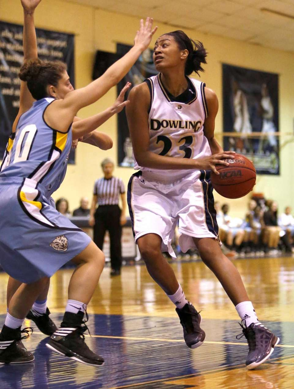 Dowling's Danielle Wilson (23) turns into the paint