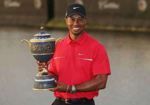 Tiger Woods poses with the Gene Sarazen Cup