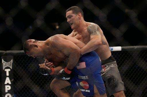 Chris Weidman, right, of Long Island, defeated Mark