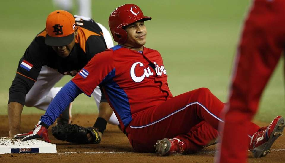 Cuba's designated hitter Frederich Cepeda is tagged out