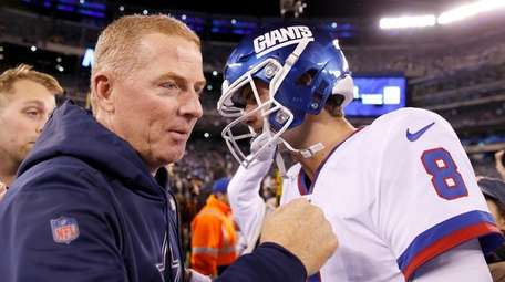 Jason Garrett, then the Cowboys coach, greets Daniel