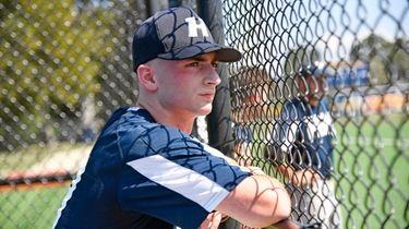 Mark Faello watches his team bat in a