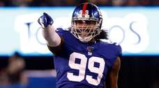 Leonard Williams of the Giants reacts after his