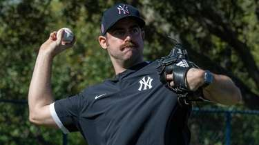 Yankees pitcher Nick Tropeano works through drills during