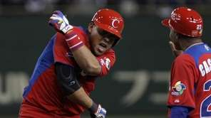 Yasmany Tomas of Cuba reacts after hitting a