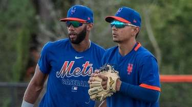 Mets infielders Amed Rosario, left, and Andres Gimenez