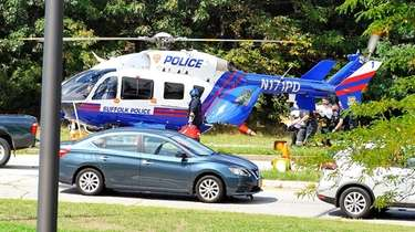 A Suffolk County police helicopter transported a woman