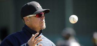 Former Atlanta Braves third baseman Chipper Jones catches