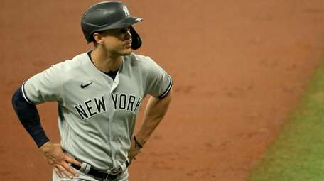 Giancarlo Stanton of the Yankees looks on during