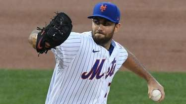 Mets starting pitcher David Peterson delivers against the