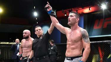 Chris Weidman reacts after his victory over Omari