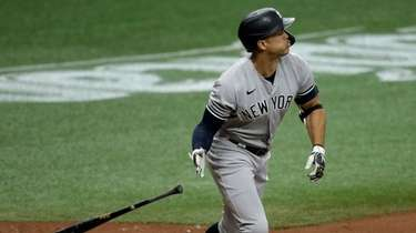 Yankees' Giancarlo Stanton drops his bat as he
