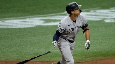 Yankees' Giancarlo Stanton drops his bat as he