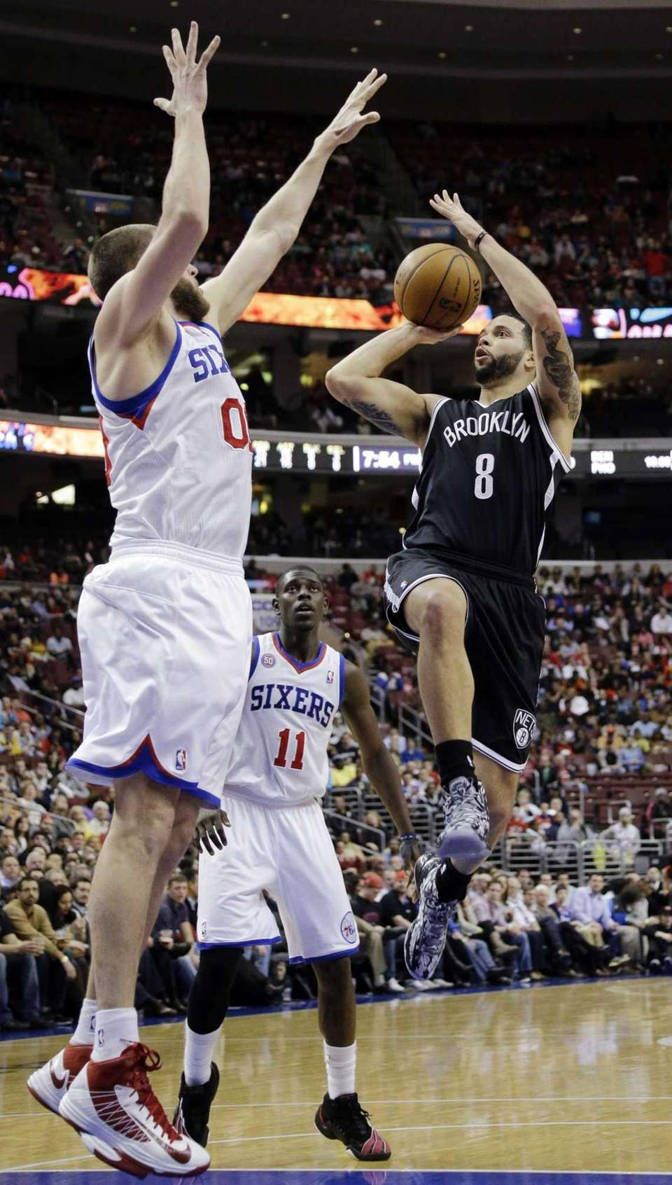 Nets' Deron Williams shoots against Philadelphia 76ers' Spencer