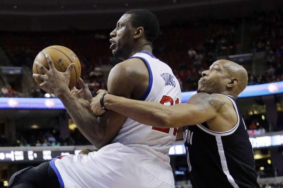 Philadelphia 76ers' Thaddeus Young is fouled by Nets'