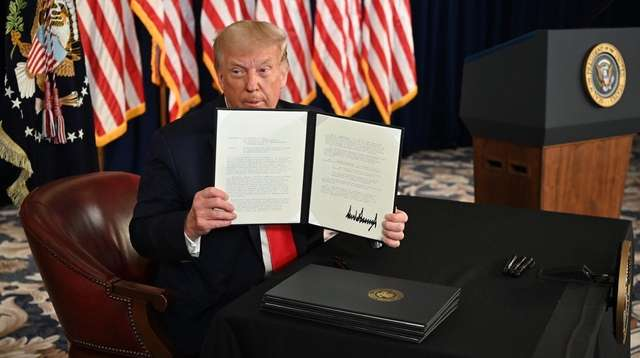 President Donald Trump on Saturday signs executive orders