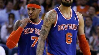 Carmelo Anthony and Tyson Chandler look at the