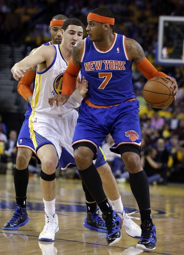 Carmelo Anthony drives the ball against Golden State