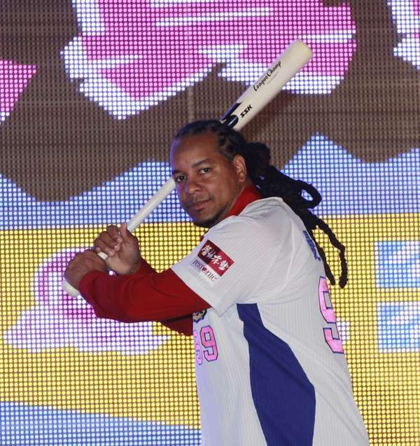 Former MLB star Manny Ramirez poses for media