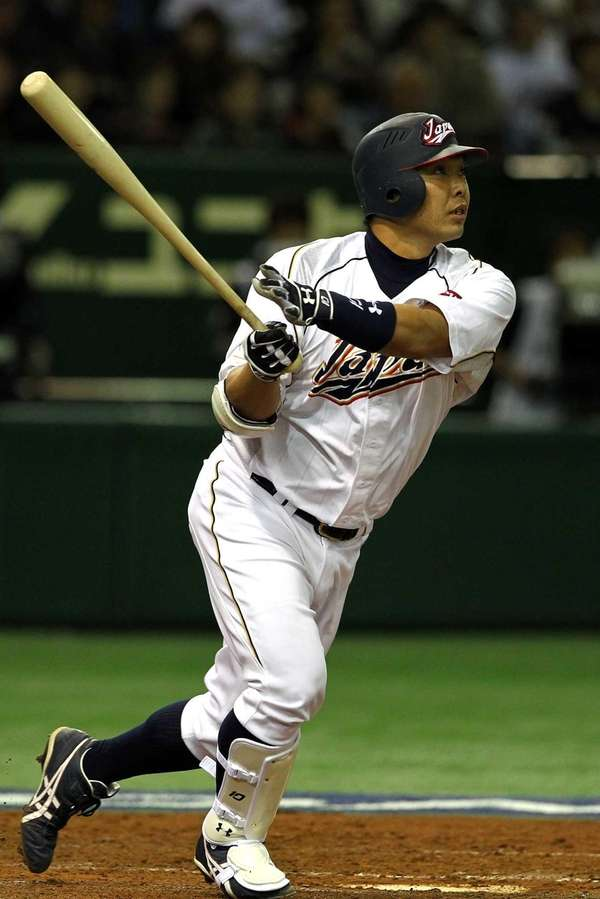 Catcher Shinnosuke Abe of Japan hits a homer