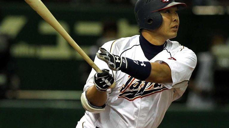 Catcher Shinnosuke Abe of Japan hits a homer