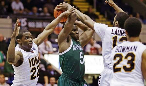Manhattan forward Rhamel Brown is surrounded by Iona